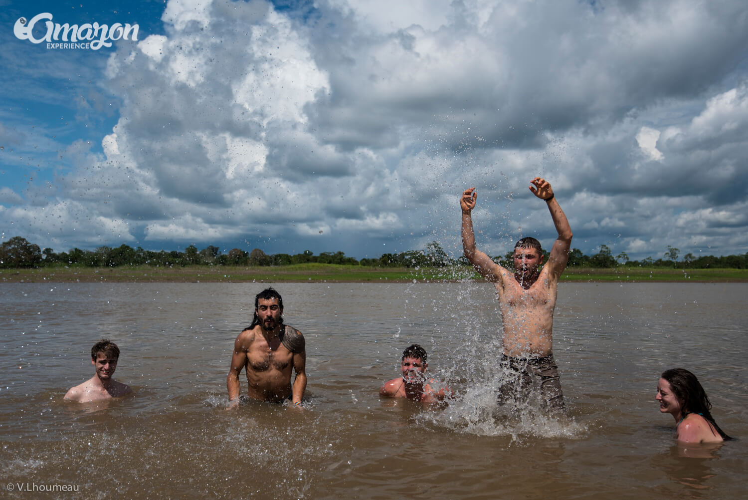 People jumping in the Amazon river