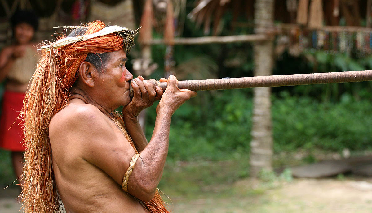 Yagua tribe member using a blowgun
