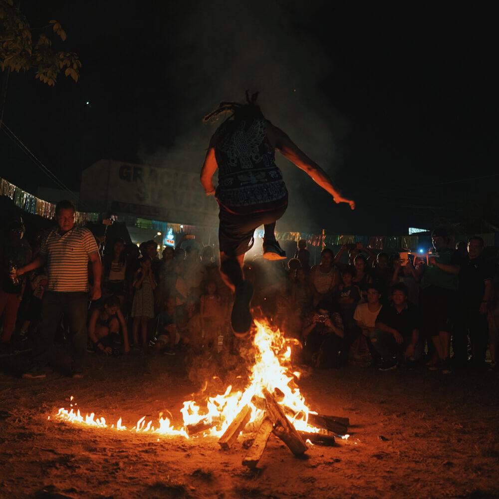 Jumping fire in Saint John festival. Iquitos, Peru